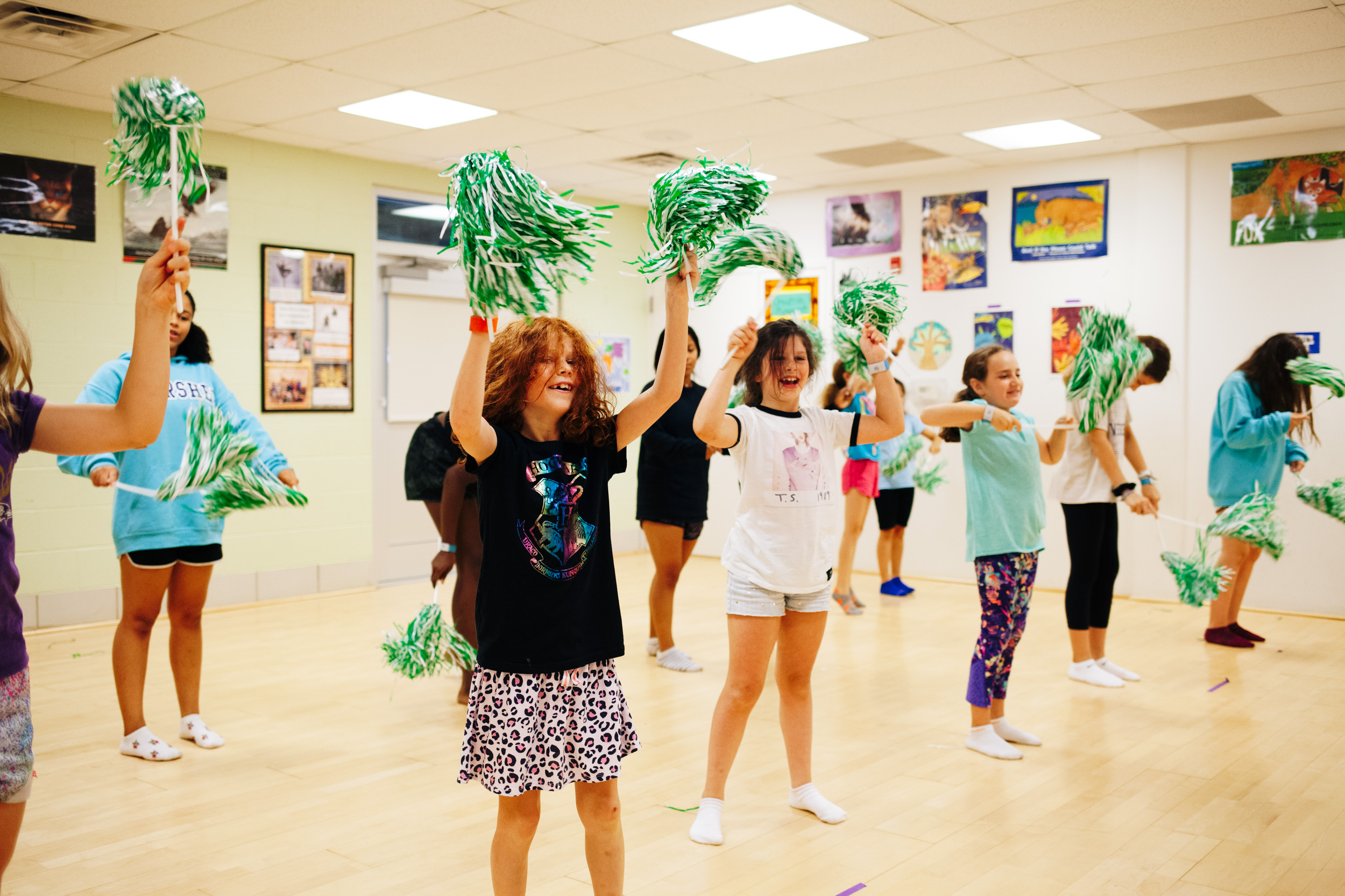 Campers learning pom pom cheers and routines
